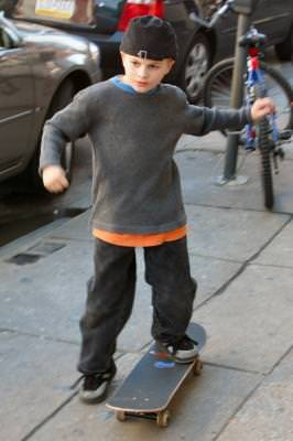 boy, kid, skateboard, street, skateboarding, sidewalk, cap, streetwise, Philadelphia, Pennsylvania, play, fun, joy, action, leisure,