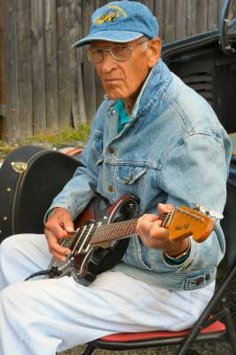 musician, guitar, music, flea market, country, people, man, denim, elderly, senior, outdoor, outside, color, vertical,